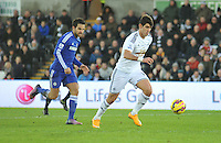 SWANSEA, WALES - JANUARY 17:   of  during the Barclays Premier League match between Swansea City and Chelsea at Liberty Stadium on January 17, 2015 in Swansea, Wales. Swansea's Nelson Oliviera on the ball