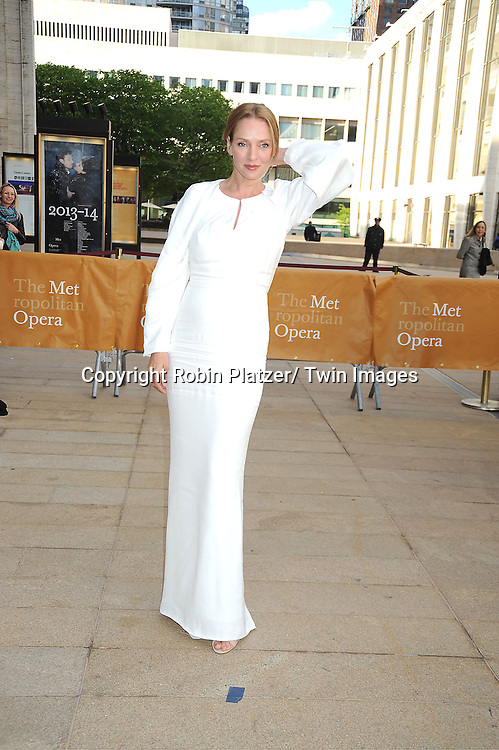 Uma Thurman in white Fendi dress attends the American Ballet Theatre's Spring Gala on May 13, 2013 at The Metropolitan Opera House in New York City.