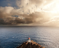 Makapu'u Lighthouse, a familiar O'ahu landmark, at sunrise with a view of the Pacific Ocean