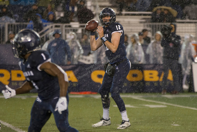 Nevada quarterback Carson Strong (12) looks to pass the ball in the rain against Hawaii in the first half of an NCAA college football game in Reno, Nev., Saturday, Sept. 28, 2019. (AP Photo/Tom R. Smedes)