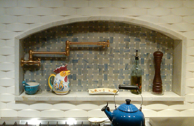 Custom Basketweave Backsplash shown in 3x5 cm Blue Lightning with Bianco Antico accents.