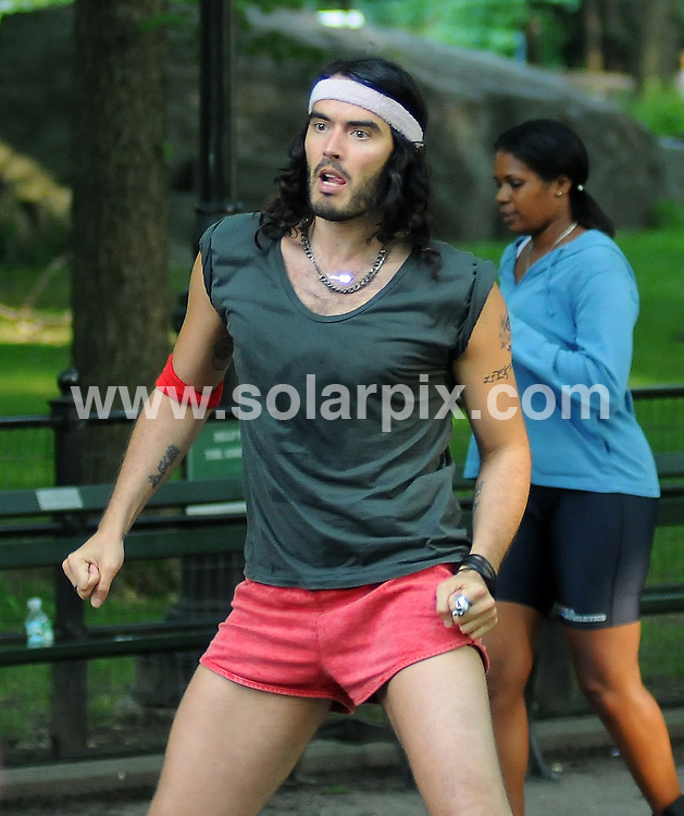 "**ALL ROUND PICTURES FROM SOLARPIX.COM**.**SYNDICATION RIGHTS FOR UK, AUSTRALIA, DENMARK, PORTUGAL, S. AFRICA, SPAIN & DUBAI (U.A.E) ONLY**.Russell Brand filming ""Get Him to the Greek"" and taking time out to pose for photographs with fans and onlookers in Central Park in New York, USA. 30 July 2009..This pic: Russell Brand..JOB REF: 9645 PHZ    DATE: 30_07_2009.**MUST CREDIT SOLARPIX.COM OR DOUBLE FEE WILL BE CHARGED**.**MUST NOTIFY SOLARPIX OF ONLINE USAGE**.**CALL US ON: +34 952 811 768 or LOW RATE FROM UK 0844 617 7637**"