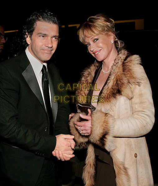 "ANTONIO BANDERAS & MELANIE GRIFFITH.The World Premiere of ""Take the Lead"" at Lowes Lincoln Square Theatre, New York, NY, USA..April 4th, 2006.Photo: Jackson Lee/Admedia/Capital Pictures.Ref: JL/ADM.headshot portrait.half length celebrity couple married husband wife black brown beige fur coat.www.capitalpictures.com.sales@capitalpictures.com.© Capital Pictures."