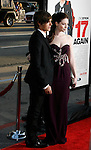 """HOLLYWOOD, CA. - April 14: Zac Efron and Michelle Trachtenberg arrive at the premiere of Warner Bros. """"17 Again"""" held at Grauman's Chinese Theatre on April 14, 2009 in Hollywood, California."""