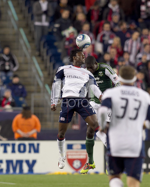 New England Revolution forward Kenny Mansally (7) and Portland Timbers midfielder James Marcelin (14) battle for head ball. In a Major League Soccer (MLS) match, the New England Revolution tied the Portland Timbers, 1-1, at Gillette Stadium on April 2, 2011.