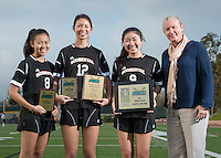 The Occidental College women's soccer team's three award winners, from left; Michaela Tsuha '16, 1st Team All-SCIAC, Taryn Ng '15, 1st Team All-SCIAC & Brine Award of Distinction, Julie Khil '17, SCIAC Women's Soccer Athlete of the Year and Jaime Hoffman, Director of Athletics. Dec. 11, 2014. (Photo by Marc Campos, Occidental College Photographer)