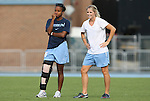 27 September 2009: North Carolina's Nikki Washington (left) with former player and current assistant coach Mandy Moraca (right). The University of North Carolina Tar Heels defeated the Wake Forest University Demon Deacons 4-0 at Fetzer Field in Chapel Hill, North Carolina in an NCAA Division I Women's college soccer game.
