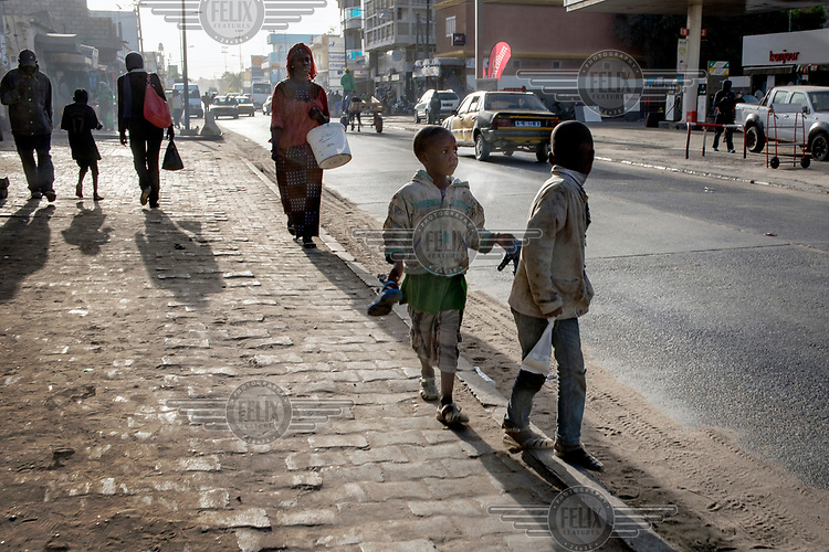 Talibe (children who live and study the Koran at a Daara, religious school) roam the streets begging for money and searching for food. <br /> Talibe often have issues that stem from being separated from their parents at a young age and the abuse they endure at the Daaras where they are expected to beg to raise money for the Daara's marabout and to get food to fed themselves.