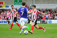 Lincoln City's Alex Woodyard vies for possession with Exeter City's Ryan Harley<br /> <br /> Photographer Andrew Vaughan/CameraSport<br /> <br /> The EFL Sky Bet League Two Play Off First Leg - Lincoln City v Exeter City - Saturday 12th May 2018 - Sincil Bank - Lincoln<br /> <br /> World Copyright &copy; 2018 CameraSport. All rights reserved. 43 Linden Ave. Countesthorpe. Leicester. England. LE8 5PG - Tel: +44 (0) 116 277 4147 - admin@camerasport.com - www.camerasport.com