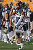 Pitt wide receiver Tyler Boyd (23) relaxes before the game. The Miami Hurricanes football team defeated the Pitt Panthers 29-24 on  Friday, November 27, 2015 at Heinz Field, Pittsburgh, Pennsylvania.