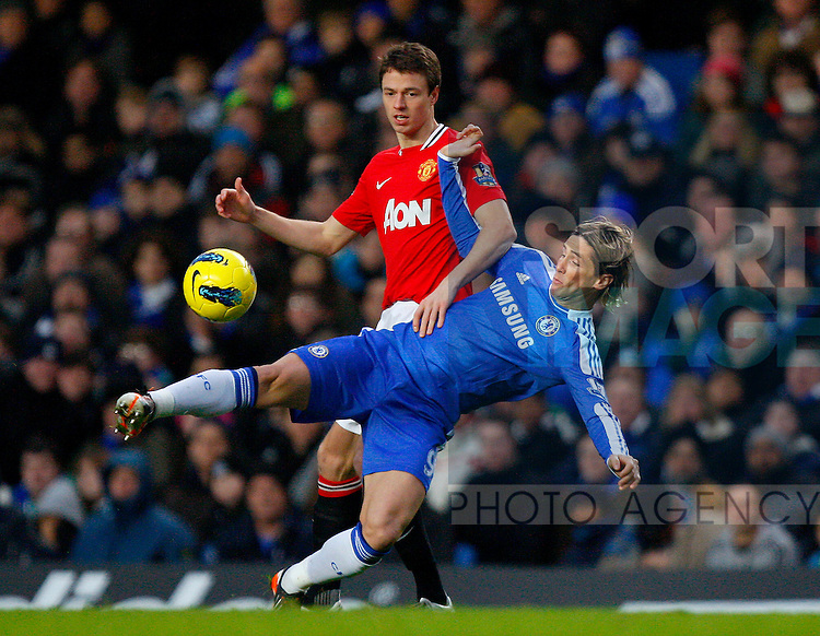 Fernando Torres of Chelsea holds off Jonny Evans of Manchester United.Barclays Premier League.Chelsea v Manchester United at Stamford Bridge, London.5th February, 2012.--------------------.Sportimage +44 7980659747.picturedesk@sportimage.co.uk.http://www.sportimage.co.uk/.Editorial use only. Maximum 45 images during a match. No video emulation or promotion as 'live'. No use in games, competitions, merchandise, betting or single club/player services. No use with unofficial audio, video, data, fixtures or club/league logos.