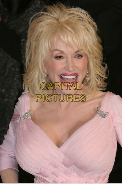 DOLLY PARTON.2006 Vanity Fair Oscar Party held at Morton's, West Hollywood, California, USA..March 5th, 2006.Photo: Charles Harris/AdMedia/Capital Pictures.Ref: CH/ADM.headshot portrait diamond brooch mouth open lip liner.www.capitalpictures.com.sales@capitalpictures.com.© Capital Pictures.