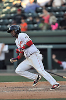 Right fielder Joseph Monge (15) of the Greenville Drive bats in a game against the Columbia Fireflies on Sunday, April 24, 2016, at Fluor Field at the West End in Greenville, South Carolina. Greenville won, 5-1. (Tom Priddy/Four Seam Images)