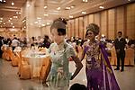 PHNOM PHEN, CAMBODIA, APRIL 2013:<br />Va Spophors e Thy Angsela, celebrano il loro Matrimonio nella sala A del complesso di Diamond Island<br /><br />L'alta borghesia khmer festeggia al Diamond Island Convention &amp; Exhibition Center, nuovo complesso creato su Koh Pich (Diamond Island), isola fluviale nel centro di Phnom Penh che nel sogno degli azionisti della Canadia Bank (tra cui, si mormora, la famiglia di Hun Sen, primo ministro in carica dal 1985) dovrebbe divenire una micro Singapore. Le dieci sale di Diamond Island possono accogliere un totale di 2000 persone, ma le tariffe sono molto pi&ugrave; alte: il minimo &egrave; di 250 dollari per un tavolo da dieci (cena compresa), la media di circa 400. &copy; Giulio Di Sturco per &quot;D&quot; della Repubblica