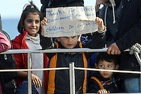 Pictured: Two young children holding a makeshift sign thanking Greece for accepting them Thursday 27 November 2014<br />
