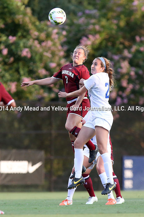 14 August 2014: South Carolina's Savannah McCaskill (7) and Duke's Danielle Duhl (23). The Duke University Blue Devils hosted the University of South Carolina Gamecocks at Koskinen Stadium in Durham, NC in a 2014 NCAA Division I Women's Soccer preseason match. Duke won the exhibition 2-0.