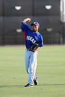 Desmond Henry  of the AZL Rangers warms up before an Arizona League game against the AZL Mariners at the Mariners complex on July 8, 2011 in Peoria, Arizona. (Bill Mitchell/Four Seam Images)