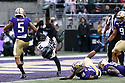 SEATTLE, WA - SEPTEMBER 14:  Hawaii (26) Miles Reed (RB) gets flipped into the end zone after taking a hit from Washington's (16) Cameron Williams (DB) during the college football game between the Washington Huskies and the Hawaii Rainbow Warriors on September 14, 2019 at Husky Stadium in Seattle, WA. Jesse Beals / www.Olympicphotogroup.com