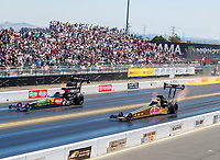 Jul 30, 2017; Sonoma, CA, USA; NHRA top fuel driver Leah Pritchett (right) against Terry McMillen during the Sonoma Nationals at Sonoma Raceway. Mandatory Credit: Mark J. Rebilas-USA TODAY Sports