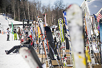 Skiers enjoy the sun on a bluebird day at a Michigan resort.
