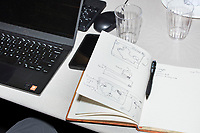 A notebook with sketches of voting districts lays on a table next to Ariel M'ndange-Pfupfu, 33, of Washington, D.C., (left) at the Metric Geometry and Gerrymandering Group (MGGG) hackathon at the Data Lab in the Tisch Library at Tufts University in Medford, Massachusetts, USA, on Thurs., Aug. 10, 2017. M'ndange-Pfupfu is a Data Scientist at The Data Incubator in DC. The hackathon is part of the first in a series of Geometry of Redistricting workshops put on by the MGGG. Academics, Geographic Information Systems (GIS) professionals, and legal professionals worked together to build tools useful in analyzing voting district data around the country.