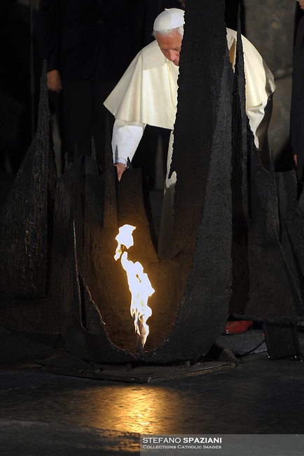 Pope Benedict XVI prays after laying a wreath at the eternal flame, commemorating the six million Jews killed by the Nazis in the Holocaust, during a ceremony in the Hall of Remembrance at Yad Vashem Holocaust memorial in Jerusalem May 11, 2009.