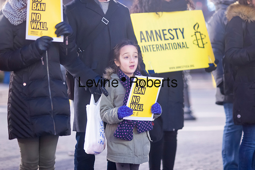 """Protesters gather in Union Square Park in New York on Friday, February 3, 2017 to show their displeasure with President Donald Trump's executive orders relating to a ban on Muslims entering the country and his plans to build a wall between the U.S. and Mexico. The action, organized by Amnesty International, had the group line up and form a """"human wall"""" in the park as they chanted and held signs.  (© Richard B. Levine)"""