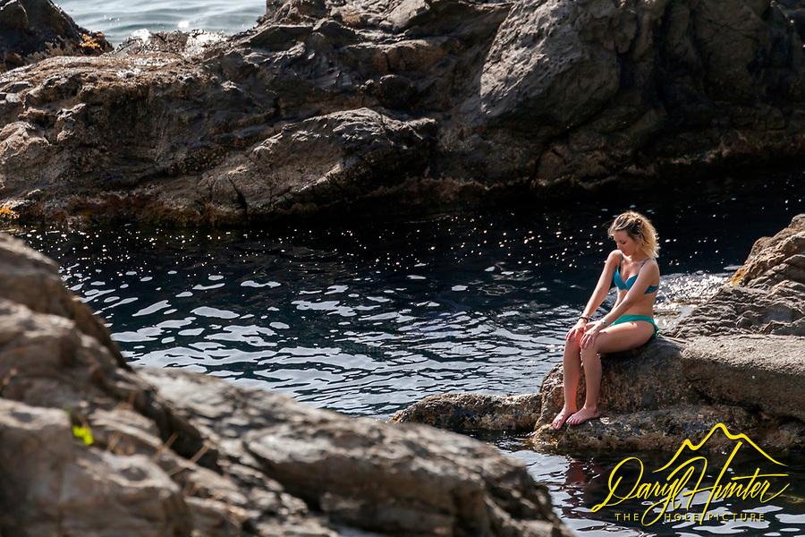 Sunbather, Manarola harbor, Cinque Terre Italy