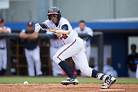 Isranel Wilson (12) of the Danville Braves lays down a bunt against the Princeton Rays at American Legion Post 325 Field on June 25, 2017 in Danville, Virginia.  The Braves walked-off the Rays 7-6 in 11 innings.  (Brian Westerholt/Four Seam Images)