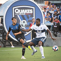 SAN JOSE, CA - AUGUST 24: Chris Wondolowski #8 of the San Jose Earthquakes and Doneil Henry #2 of the Vancouver Whitecaps during a game between Vancouver Whitecaps FC and San Jose Earthquakes at Avaya Stadium on August 24, 2019 in San Jose, California.