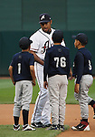 Aces players take the field with kids from a local team.  Tom Smedes photo.
