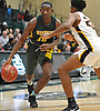 Isaiah Bien-Aise #12 of Westbury, left, dribbles downcourt as Zion Styles #23 of Uniondale guards him during the Nassau County varsity boys basketball Class AA semifinals at Farmingdale State College on Monday, Feb. 26, 2018. Uniondale won by a score of 61-44.