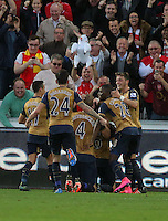 Laurent Koscielny of Arsenal celebrates his goal with team mates during the Barclays Premier League match between Swansea City and Arsenal at the Liberty Stadium, Swansea on October 31st 2015