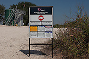 "KARNES COUNTY, TX - SEPTEMBER 25, 2013: Detail of an entrance to a well site, with a sign warning of ""Poisonous Gas: H2S Present"". H2S is Hydrogen Sulfide gas. CREDIT: Lance Rosenfield/Prime"