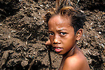 "A decade after it was closed, children like this boy continue to scavenge in ""Smokey Mountain"", an infamous Manila dumpsite. They are searching for items of value, including plastic, glass and metal, that can be recycled..."