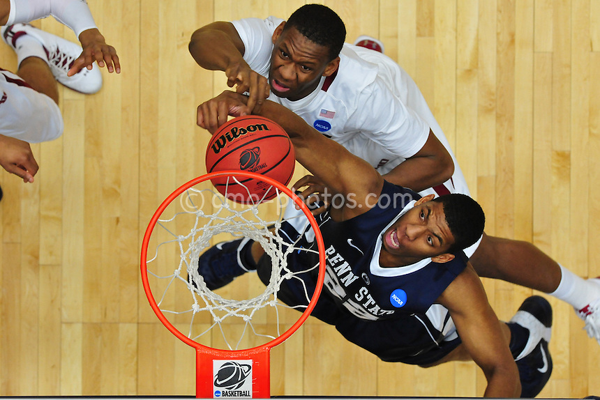 Mar 17, 2011; Tucson, AZ, USA; Penn State Nittany Lions forward Andrew Jones (22) reacts after hittting the rim on a dunk attempt in the first half of a game against the Temple Owls in the second round of the 2011 NCAA men's basketball tournament at the McKale Center. The Aztecs won 68-50.