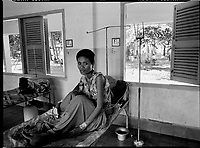 Battambang, Cambodia, December 2006..Po Tiane Tey, 26, is waiting for the results of her Tuberculosis testing in the admission ward from the Battambang provincial hospital. TB is endemic in the region, fueled by poverty, malnutrition, inadequate hygiene and the spreading of HIV/AIDS.