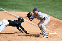 Burlington Bees first baseman Eric Aguilera (29) takes a throw as Shawon Dunston (3) dives back to first on a pick off attempt during a game against the Kane County Cougars on August 20, 2014 at Third Bank Ballpark in Geneva, Illinois.  Kane County defeated Burlington 7-3.  (Mike Janes/Four Seam Images)