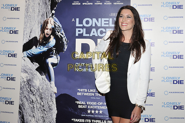 Kate Magowan.UK premiere of 'A Lonely Place To Die' at Empire Leicester Square, London, England. .September 7th, 2011.half length black dress white blazer .CAP/MAR.© Martin Harris/Capital Pictures.