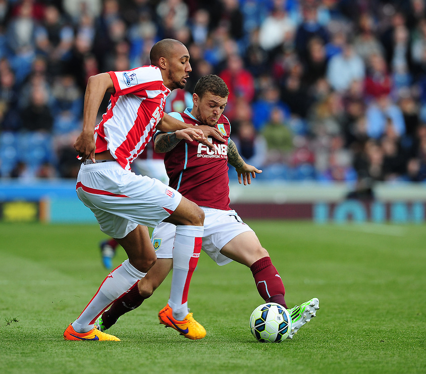 Burnley's Kieran Trippier vies for possession with Stoke City's Steven N'Zonzi<br /> <br /> Photographer Chris Vaughan/CameraSport<br /> <br /> Football - Barclays Premiership - Burnley v Stoke City - Saturday 16th May 2015 - Turf Moor - Burnley<br /> <br /> &copy; CameraSport - 43 Linden Ave. Countesthorpe. Leicester. England. LE8 5PG - Tel: +44 (0) 116 277 4147 - admin@camerasport.com - www.camerasport.com