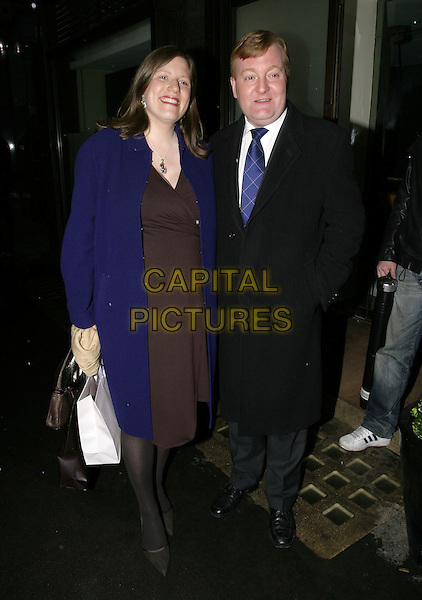 CHARLES KENNEDY & WIFE.Pre-BAFTA Party, hosted by Vogue Magazine,  Cecconi, London, February 10th 2005..full length .Ref: AH.www.capitalpictures.com.sales@capitalpictures.com.©Capital Pictures.