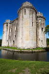 Historic stone ruins and moat of Nunney Castle, Somerset, England, UK