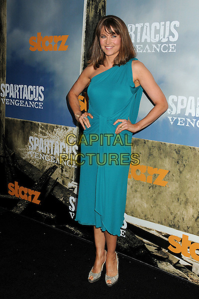 "Lucy Lawless.""Spartacus: Vengeance"" Premiere Screening held at Arclight Cinemas, Hollywood, California, USA..January 18th, 2012.full length dress hands on hips blue teal one shoulder  .CAP/ADM/BP.©Byron Purvis/AdMedia/Capital Pictures."