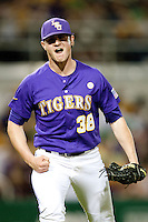 LSU Tigers picher Nick Rumbelow #38 celebrates recording the last out of the 8th inning against the Mississippi State Bulldogs during the NCAA baseball game on March 17, 2012 at Alex Box Stadium in Baton Rouge, Louisiana. The 10th-ranked LSU Tigers beat #21 Mississippi State, 4-3. (Andrew Woolley / Four Seam Images).