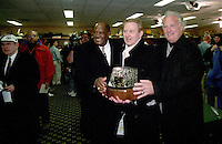 "Green Bay Packer Hall of Famers Willie Davis, left, and Paul Hornung, right, pose for a photo with Packers General Manager Bob Harlan and the George Halas Trophy at the conclusion of the NFC Championship against the Carolina Panthers on January 12, 1997. This was the first title game in Green Bay since the ""Ice Bowl"" in 1967."