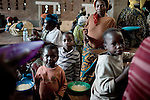 BUKAVU, DEMOCRATIC REPUBLIC OF CONGO OCTOBER 30: Unidentified women and children wait for a meal to be served on October 30, 2007 at Panzi hospital outside Bukavu, DRC. Many of these women has been raped and abused by rebels and government soldiers. Many of the children are a result of rape. About 10 women and girls show up at the hospital every day and Dr. Denis Mukwege, a gynecologist and his staff does up to 20 reconstructive operations every day. He often has to perform complicated surgery to reproductive and digestive parts of the women. The DRC conflict has seen an unprecedented high rate of rape and sexual abuse of women. The culprits are both different rebel groups and government soldiers and very few are punished. About 27,000 sexual assaults were reported in South Kivu province alone in 2006, according to the United Nations. (Photo by Per-Anders Pettersson)
