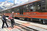 Visitors get on the Gornergrat train near the summit observatory above Zermatt, Switzerland. .  John offers private photo tours in Denver, Boulder and throughout Colorado, USA.  Year-round. .  John offers private photo tours in Denver, Boulder and throughout Colorado. Year-round.