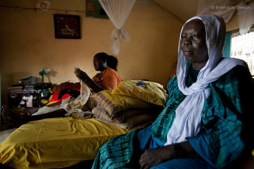 July 18, 2011 - Juba, Republic of South Sudan - Lushi Rashid (L), a 29 year old muslim South Sudanese woman, one hour before she gives birth to her fifth child at her family home with the help of Regabia Ahmad (R), a qualified birth attendant, in Juba, the capital city of South Sudan. Regabia has been delivering babies in South Sudan for over twenty years. she was trained by the health ministry and works at a local primary health clinic. With fewer than 100 trained midwives for a population of over eight million, South Sudan has the highest maternal mortality rate in the world.  One in seven South Sudanese women is likely to die because of complications from delivery. Just 10 per cent of South Sudanese women have access to medical professionals during childbirth. Photo credit: Benedicte Desrus