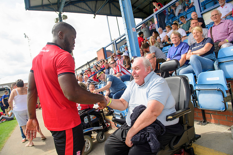 Lincoln City's John Akinde signs autographs for fans<br /> <br /> Photographer Chris Vaughan/CameraSport<br /> <br /> Football Pre-Season Friendly (Community Festival of Lincolnshire) - Lincoln City v Lincoln United - Saturday 6th July 2019 - The Martin & Co Arena - Gainsborough<br /> <br /> World Copyright © 2018 CameraSport. All rights reserved. 43 Linden Ave. Countesthorpe. Leicester. England. LE8 5PG - Tel: +44 (0) 116 277 4147 - admin@camerasport.com - www.camerasport.com