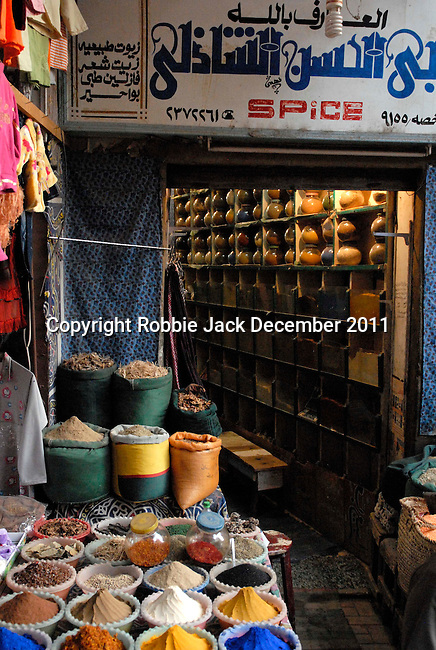 A spice shop in the Sharia Souk in Luxor.The town of Luxor occupies the eastern part of a great city of antiquity which the ancient Egytians called Waset and the Greeks named Thebes.